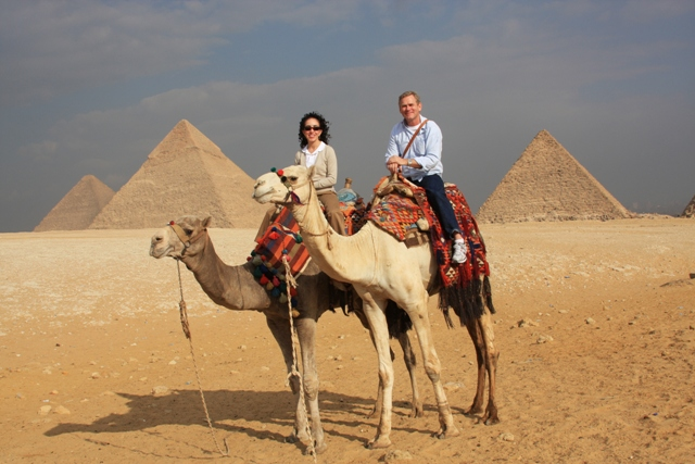 R & I riding camels in Giza, Egypt