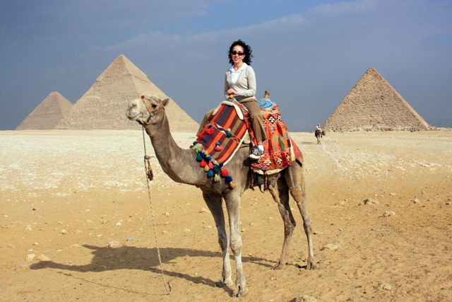 Riding a camel through Giza