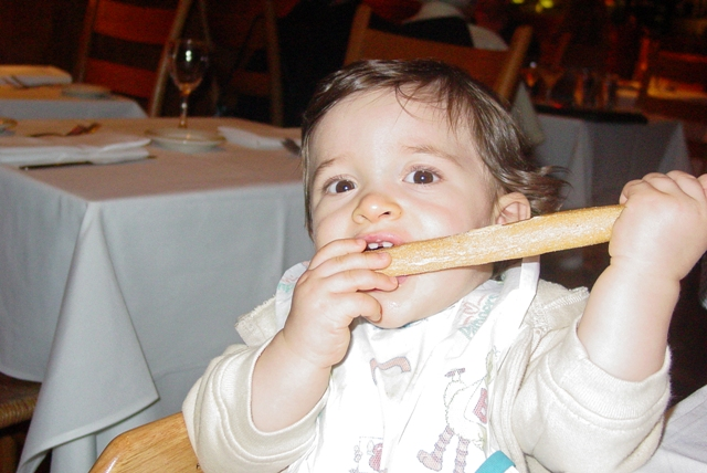 Baby C eating a breadstick