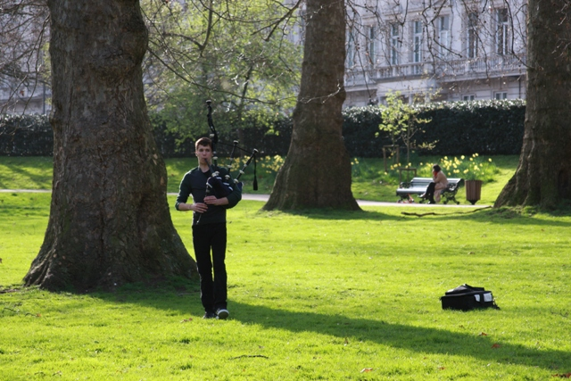 Playing bagpipes in the park