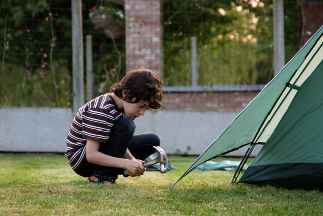 C helping set up tent